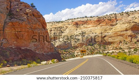 Highway through the badlands landscape of Escalante Staircase National Monument, Utah