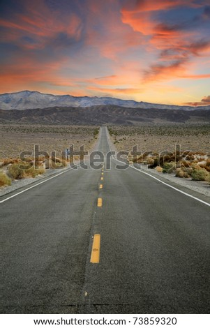 Highway to Heaven. The road to Paradise is Long and Straight but has no speed limit signs. At the end of the road you end up in that big parking lot in the sky - stock photo