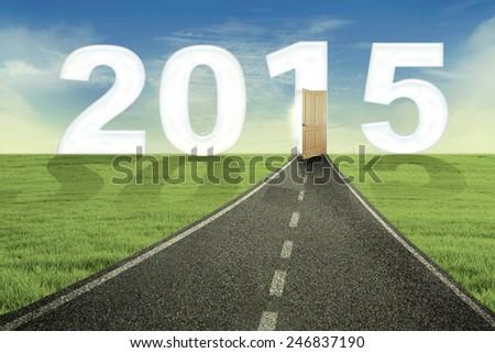 Highway toward the door of new year 2015, shot outdoors - stock photo