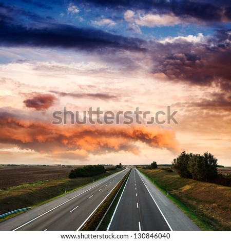 highway traffic on  summer day - stock photo