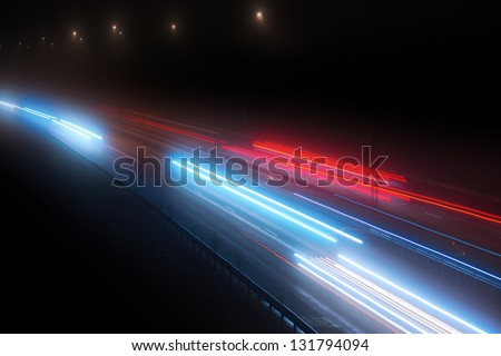 Highway traffic with blurred lights in evening