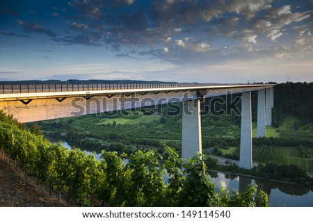 Highway transport over the Mosel valleybridge at the sunset - stock photo