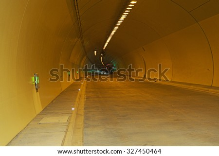 Highway Tunnel  with light and signs