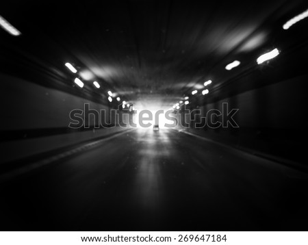 highway tunnel with motion blur in black and white style - stock photo