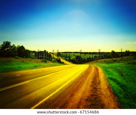 highway under clean blue sky - stock photo
