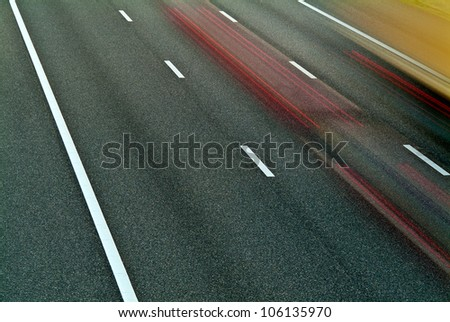 Highway with blurred cars driving by - stock photo