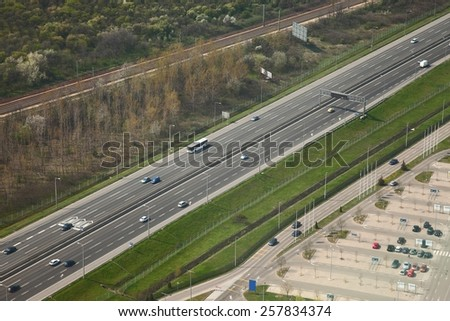 Highway with cars passing by - stock photo