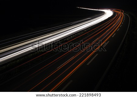 highway with light trails at nightfall