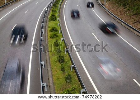 Highway with lots of car in motion - stock photo