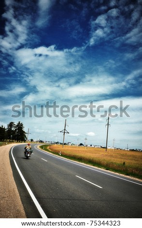 highway with motorcycle under blue sky at summer - stock photo