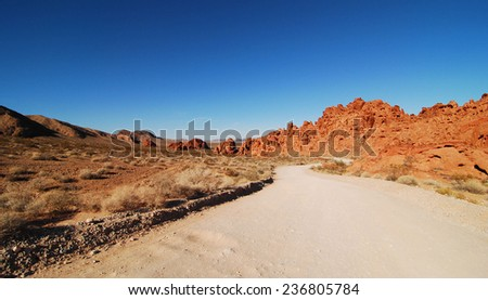 Highways and roads at the Valley of Fire / Dusty Road - stock photo