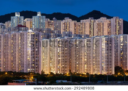 Hign density residential buildings in Hong Kong at night - stock photo