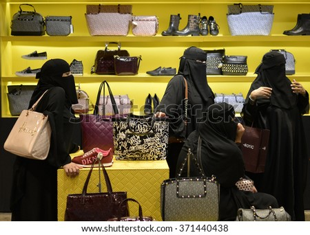 Hijab Arab ladies doing shopping in Istanbul,, Turkey 20 September 2014 - stock photo