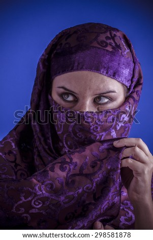 Hijab, Beautiful arabic woman with traditional veil on her face, intense look - stock photo