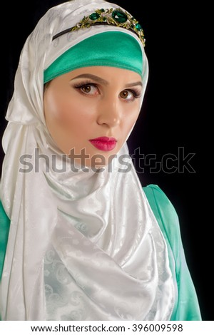 hijab. The Islamic headscarf for women and the general clothing, hides figure, wrists and neck women. Very beautiful girl - stock photo