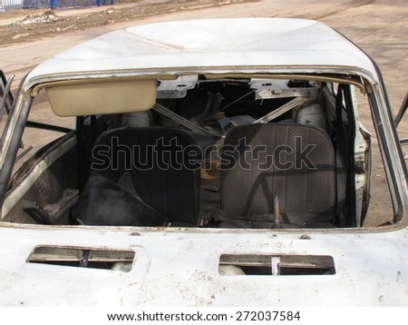 Hijacked and a crashed car in the spring city street - stock photo