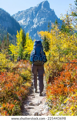 Hike in autumn mountains - stock photo