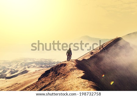 Hike in Bromo volcano - stock photo