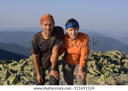 Hike in the Ukrainian Carpathians. Hiker's family on a mountain top - stock photo