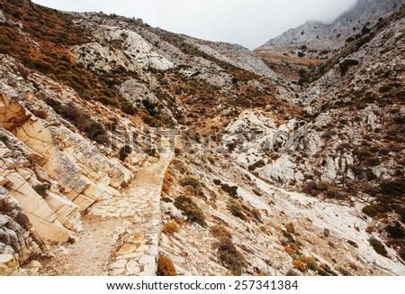 Hike up to Mount Zas (Zeus). Rock pathway up leads to the highest peak in the Greek Cyclades. Naxos, Greece.  - stock photo