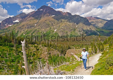 Hiker along the Scenic point trail in Glacier National park - stock photo