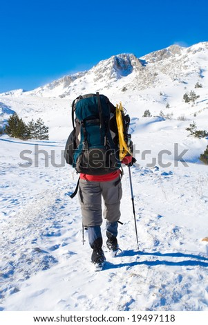 Hiker are in winter in mountains