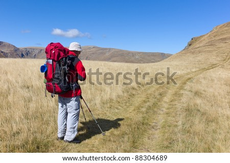 hiker at Tarcu Mountains, Southern Carpathians, Romania