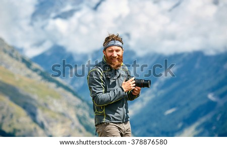 hiker at the top of a pass - stock photo