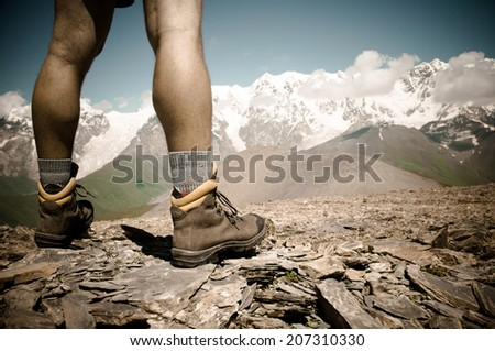 hiker at the top of the mountain - stock photo