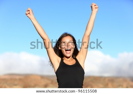 Hiker cheering. Woman hiking cheerful with arms stretched screaming of joy on top of mountain. Beautiful sporty mixed ethnicity woman outdoor. - stock photo