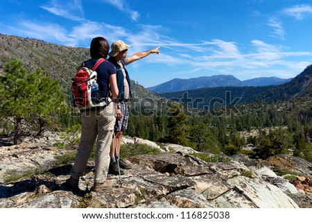 Hiker enjoying the scenery of the Sierra mountains - stock photo