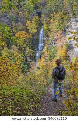 Hiker Enjoying The View Of Deh-Ga-Ya-Soh Falls At Letchworth State Park In New York - stock photo