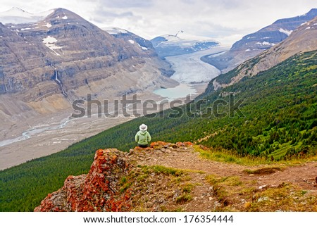 Hiker Enjoying the View of the Saskatchewan Glacier Valley in Canada - stock photo