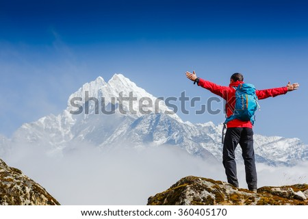 Hiker enjoying the view on the Everest trek in Himalayas, Nepal - stock photo