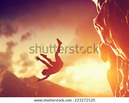 Hiker free falling from the mountain, cliff. Concept of man in dangerous or fatal situation, accident. - stock photo