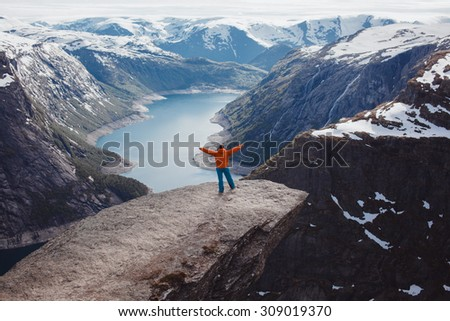 Hiker hiking with backpack looking at mountains Nature,beautiful nature landscape. Portrait of male adult back standing outdoor.Hike during trek to Trolltunga,Norway.Active healthy,strong - stock photo
