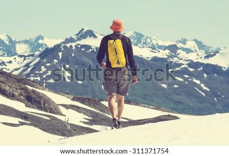 Hiker in Exit Glacier, Kenai Fjords National Park, Seward, Alaska - stock photo