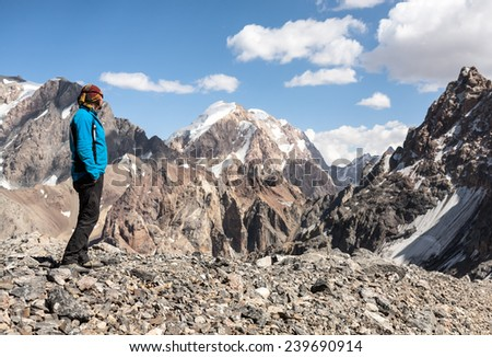 Hiker in Fann mountains, central asia, Tajikistan. - stock photo