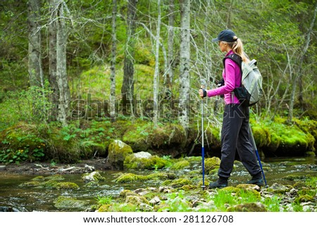 Hiker in forest - stock photo