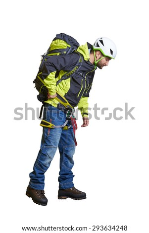 hiker in full equipment looking down. isolated on white background