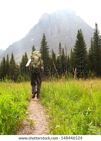 Hiker in Glacier National Park, Montana, USA - stock photo