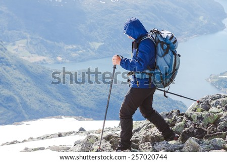 Hiker in hike in Norway - stock photo