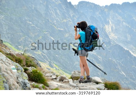 Hiker in mountains. Photographer on trail in High Tatra Mountains, Slovakia. - stock photo