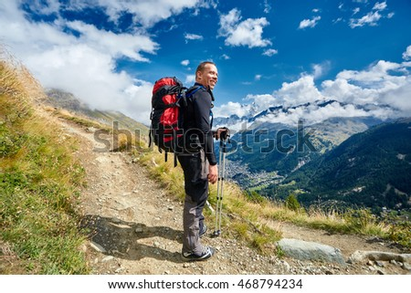 hiker in the Apls mountains. Trek near Matterhorn mount