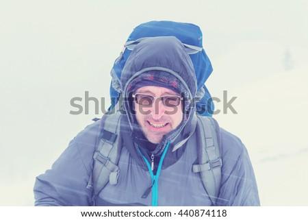 Hiker in winter - stock photo