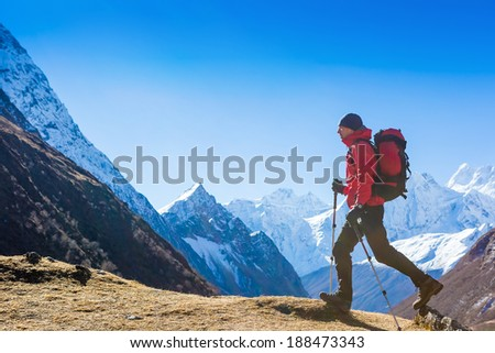 Hiker jumping in Himalaya mountains