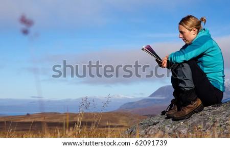 hiker looks into the hikingmap - stock photo