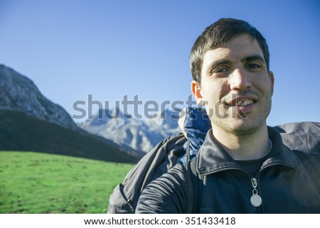 Hiker man taking a selfie during an excursion