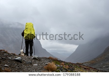 Hiker on a cloudy day in the Nallo valley in the north of sweden - stock photo
