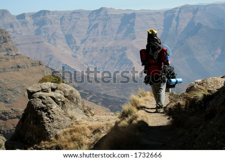 Hiker on a path - stock photo